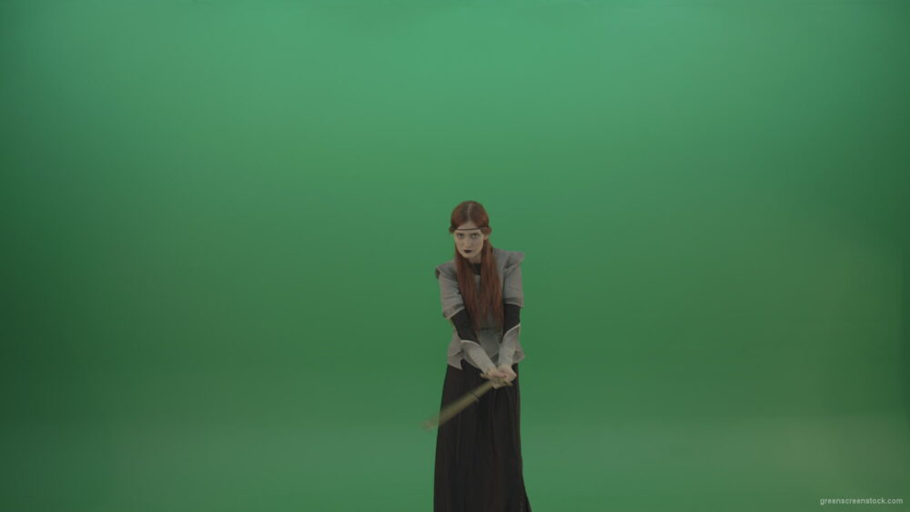 vj video background Swinging-on-a-green-background-with-a-sword-the-girl-gracefully-shows-her-strength_003