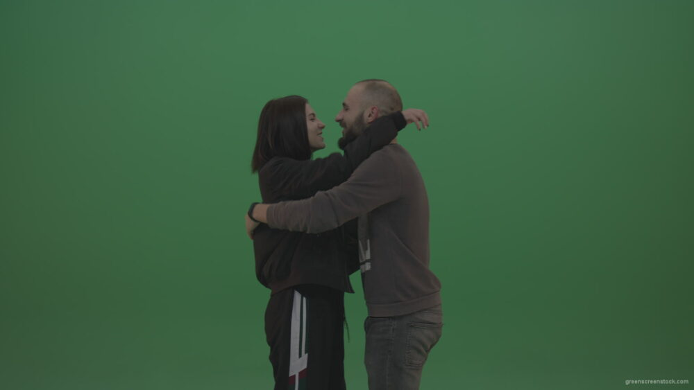 vj video background Two-people-in-black-and-grey-wear-hug-and-kiss-each-other-over-chromakey-background_003