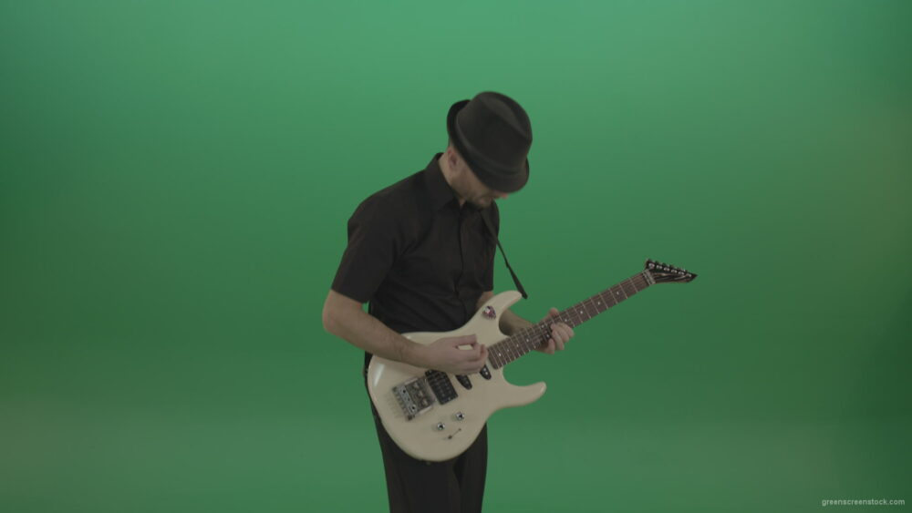 vj video background Virtuoso-guitarist-in-black-costume-and-hat-playing-solo-on-white-electro-guitar-siolated-on-green-screen_003