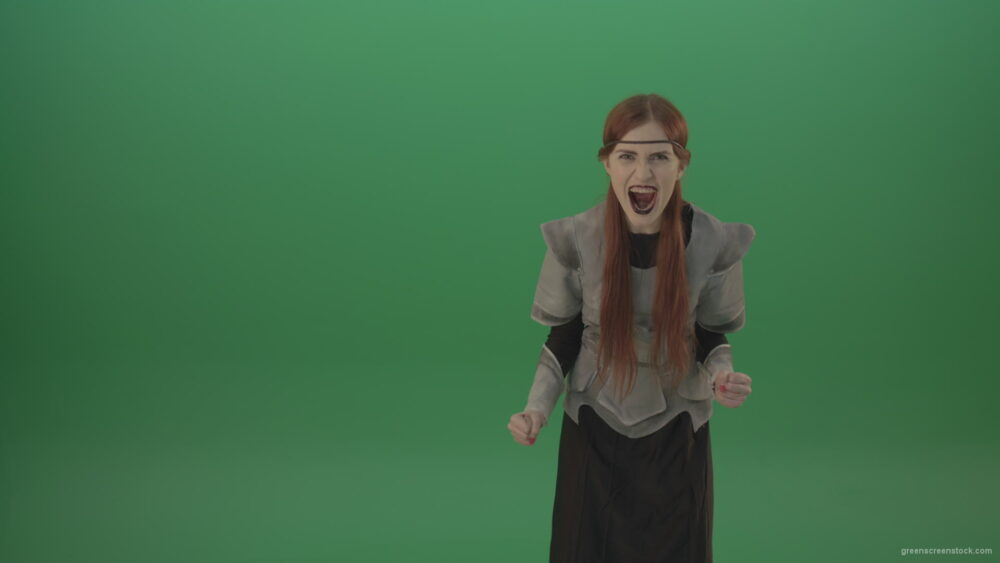 vj video background Witch-girl-watched-and-screamed-at-the-camera-with-green-eyes-on-a-green-background_003