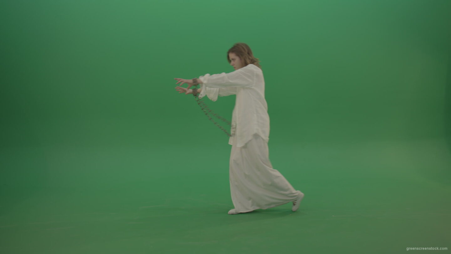 Zombie-woman-in-chains-slowly-goes-away-isolated-in-green-screen-studio_006 Green Screen Stock