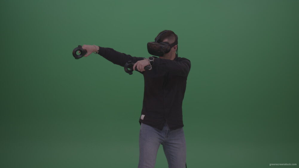 vj video background Young_Dangerous_Brunette_Man_Wearing_Black_Shirt_Shooting_Enemies_All_Around_In_Virtual_Reality_Glasses_Green_Screen_Wall_Background_003