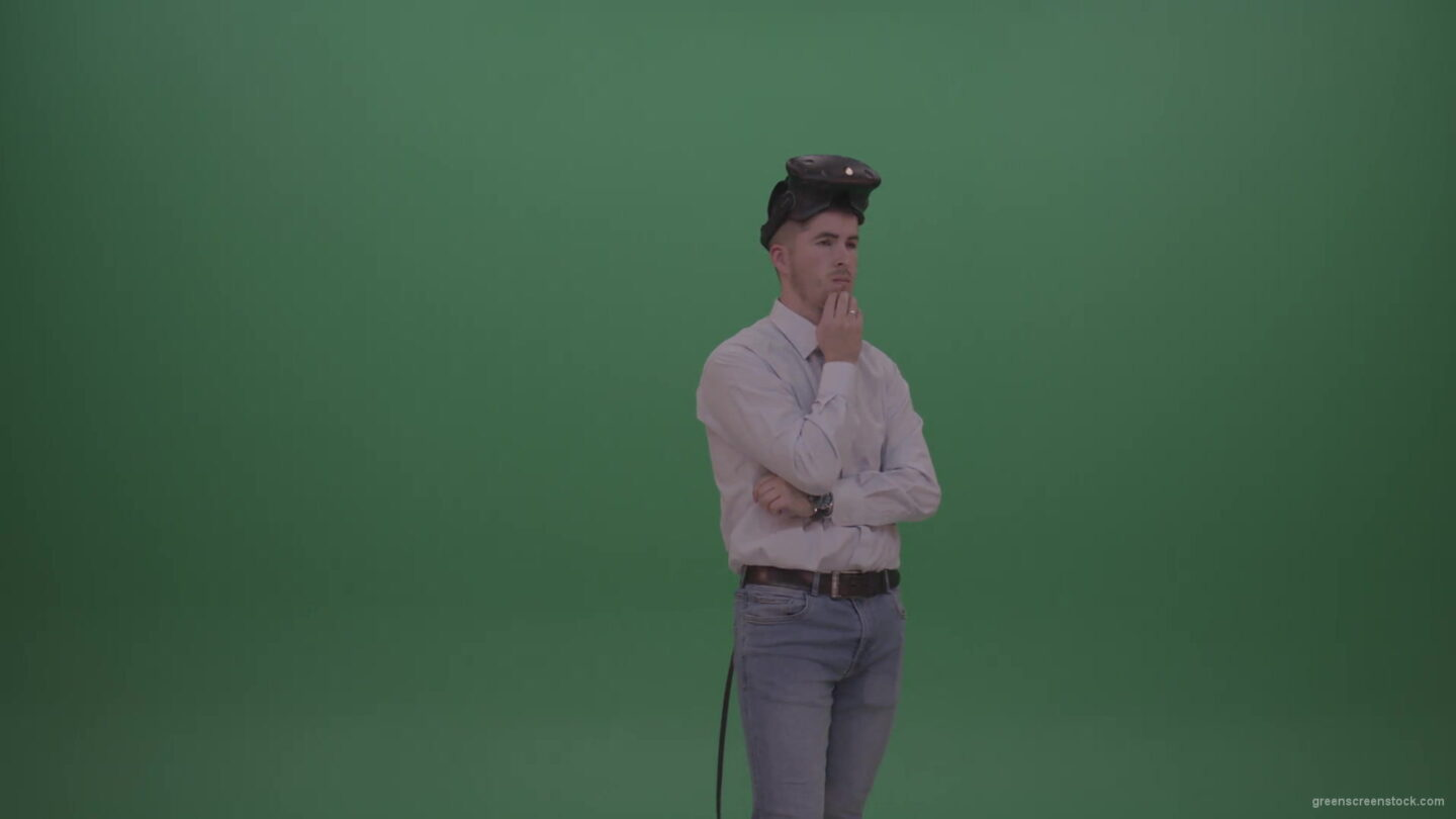 vj video background Young_Man_Wearing_White_Shirt_Making_Hard_Decision_Using_Virtual_Glasses_To_Solve_The_Task_Green_Screen_Wall_Chroma_Key_Background-1920_003