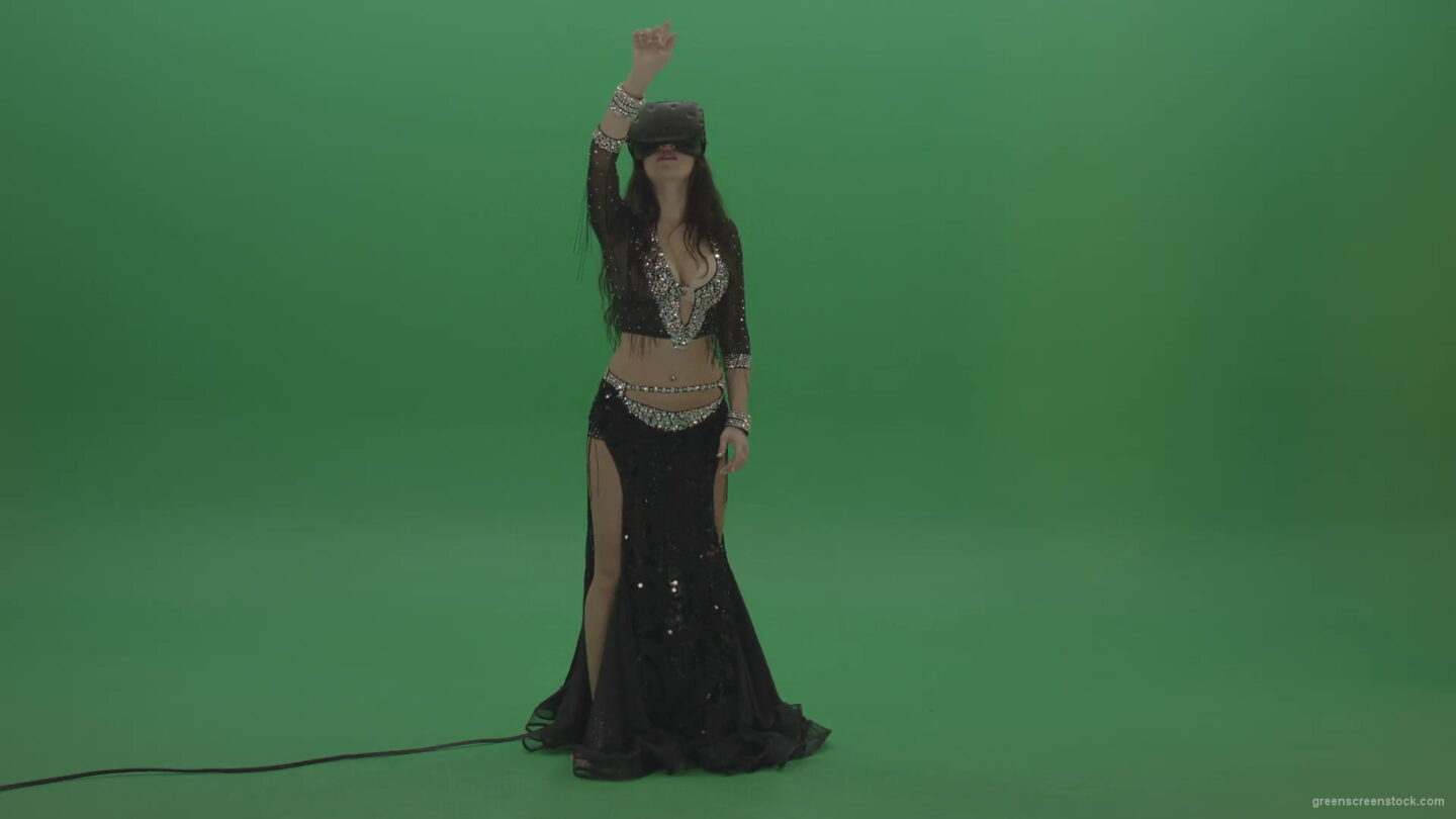 vj video background Beautiful-belly-dancer-in-VR-headset-operates-invisible-screen-over-green-screen-background-1920_003