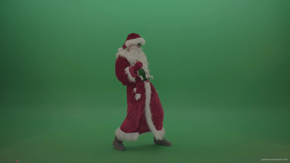 Drunk-santa-in-black-glasses-with-a-bottle-of-wine-staggers-across-the-green-screen-background-1920_008 Green Screen Stock