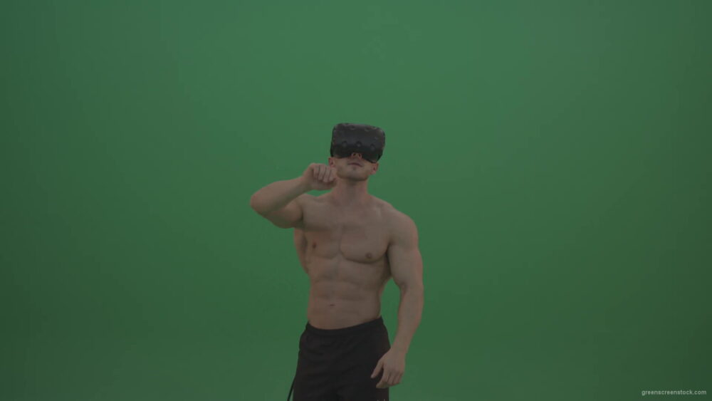 vj video background Young_Athletic_Bodybuilder_Working_On_Touch_Pad_Using_Virtual_Reality_Kit_On_Green_Screen_Wall_Background-1920_003