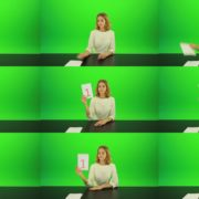 Blonde-girl-adult-gives-1-one-point-mark-score-Full-HD-Green-Screen-Video-Footage Green Screen Stock