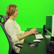 Laughing-Woman-Working-on-the-Computer-Green-Screen-Footage_002 Green Screen Stock