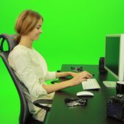 Laughing-Woman-Working-on-the-Computer-Green-Screen-Footage_004 Green Screen Stock