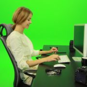 Laughing-Woman-Working-on-the-Computer-Green-Screen-Footage_006 Green Screen Stock