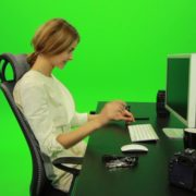 Laughing-Woman-Working-on-the-Computer-Green-Screen-Footage_008 Green Screen Stock