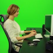 Laughing-Woman-Working-on-the-Computer-Green-Screen-Footage_009 Green Screen Stock