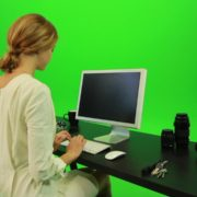 Woman-Sits-Down-and-Works-on-the-Computer-Green-Screen-Footage_004 Green Screen Stock