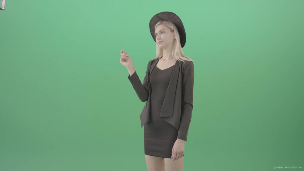 vj video background Blonde-Girl-in-Cap-choosing-virtual-products-on-touch-screen-4K-Green-Screen-Video-Footage-1920_003
