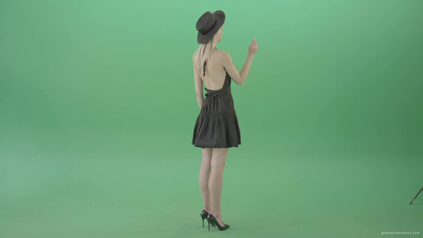 vj video background Full-size-fashion-girl-looking-virtual-products-on-touch-green-screen-4K-Video-Footage-1920_003