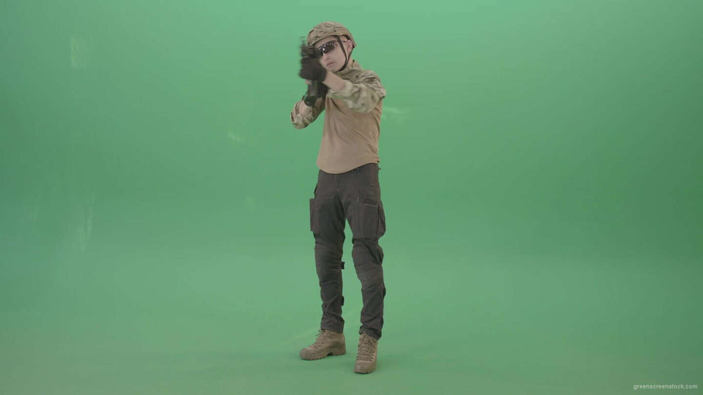vj video background Boy-in-military-uniform-shooting-with-gun-machine-on-virtual-was-over-green-screen-4K-Video-Footage-1920_003