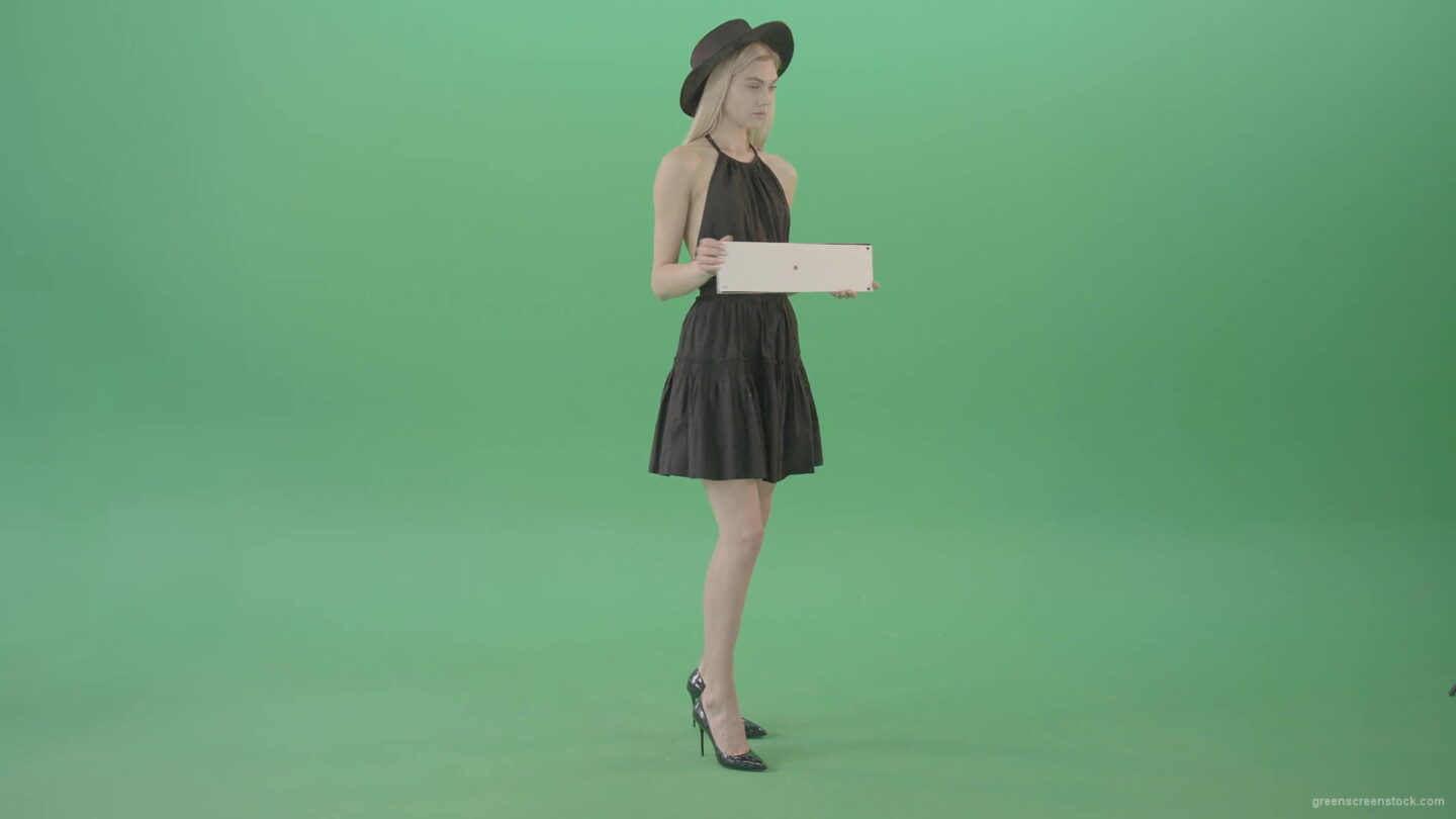 vj video background Elegant-luxury-top-model-posing-with-advertising-text-plane-mockup-template-in-hands-and-looking-to-the-camera-Green-Screen-Video-Footage-1920_003