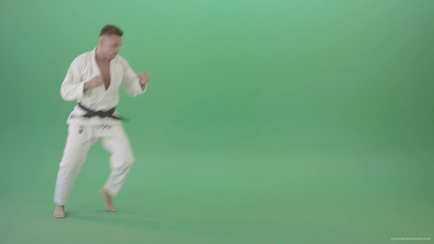 vj video background Ju-jutsu-young-man-training-slowly-karate-isolated-on-green-screen-4K-Video-Footage-1920_003