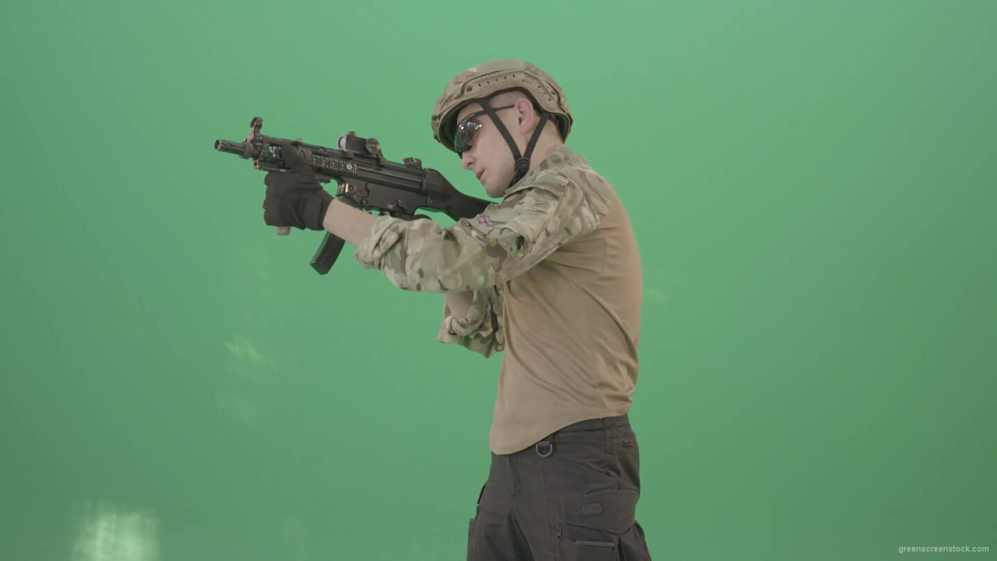 vj video background Soldier-in-army-uniform-shooting-with-gun-fire-machine-isolated-on-green-screen-4K-Video-Footage-1920_003