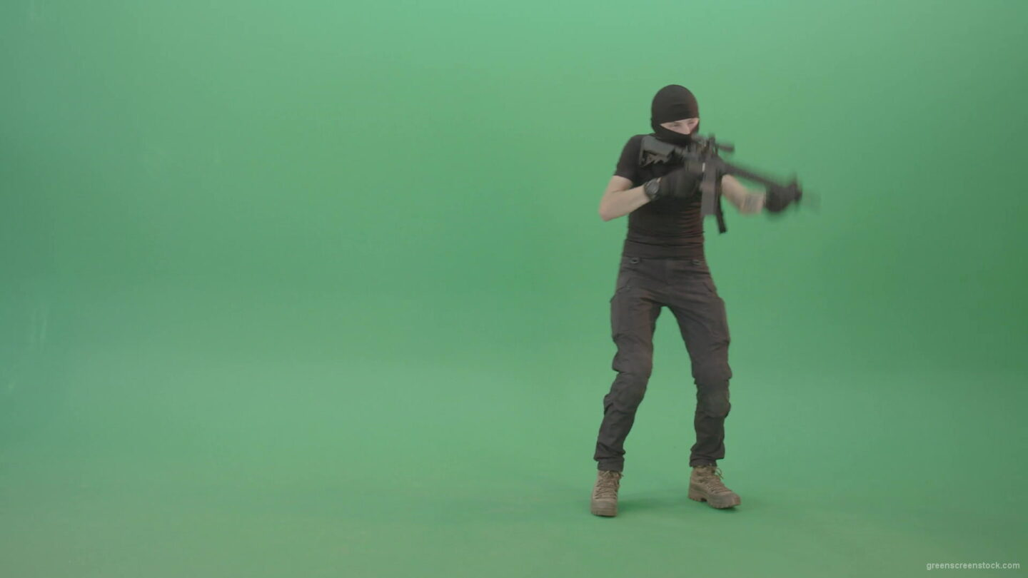 vj video background Young-Terrorist-in-mask-moving-with-machine-gun-and-shoot-enemy-on-green-screen-4K-Video-Footage-1920_003