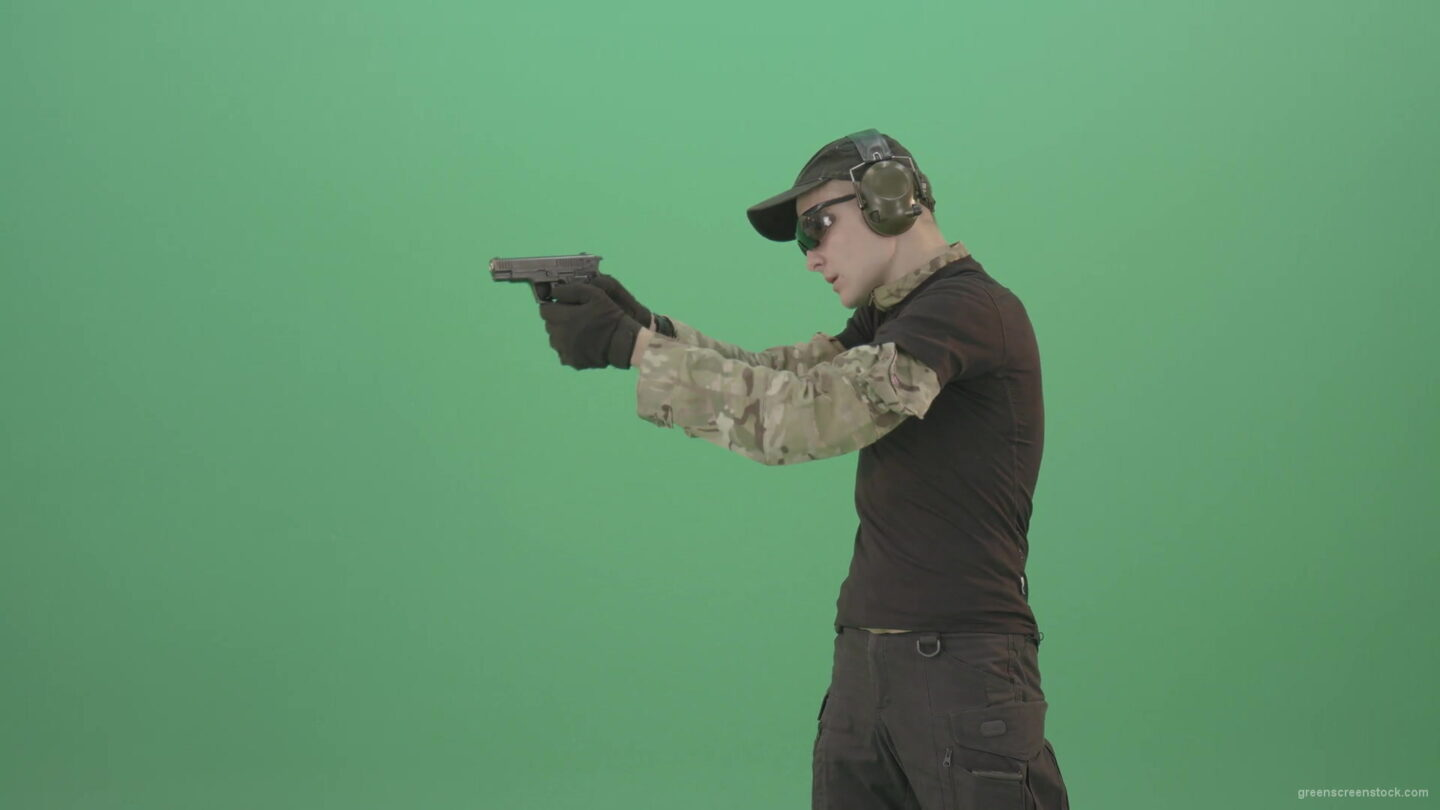 vj video background Young-boy-sodier-testin-small-pistol-gun-and-shooting-isolated-on-green-screen-4K-Video-Footage-1920_003