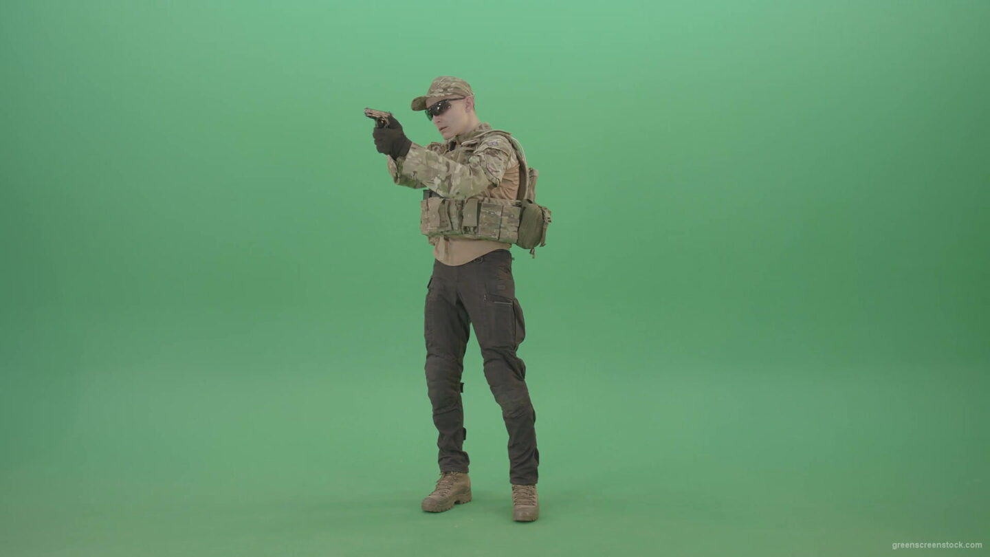 vj video background Young-striker-man-in-Bulletproof-uniform-shoot-from-pistol-gun-on-green-screen-4K-Video-Footage-1920_003