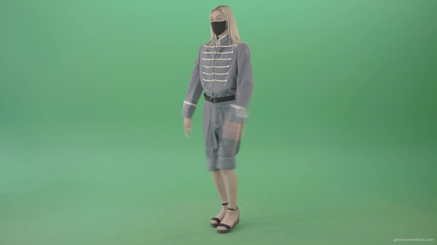 vj video background Young-Blonde-woman-marching-in-side-view-with-Covid19-mask-on-green-screen-4K-Video-Footage-1920_003