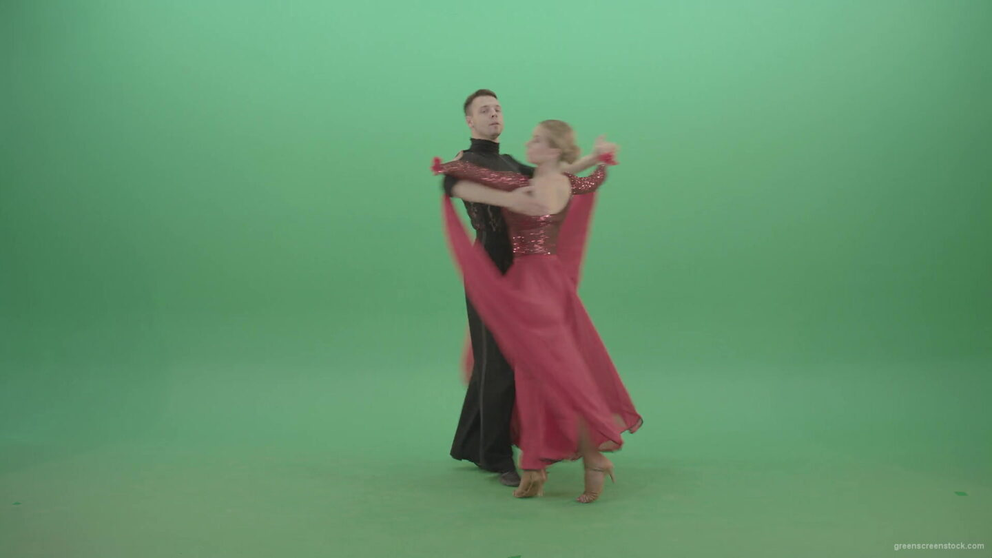 vj video background Young-couple-in-red-black-costume-spinning-dancing-ballroom-latina-dance-over-green-screen-4K-Video-Footage-1920_003