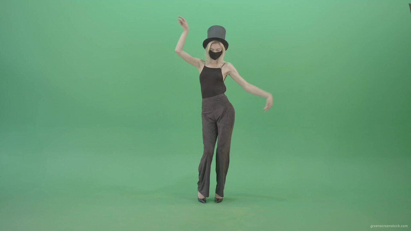 vj video background Blonde-Girl-in-Black-Cylinder-Hat-dancing-slowly-in-Corona-VIrus-Mask-on-green-screen-VIdeo-Footage-1920_003