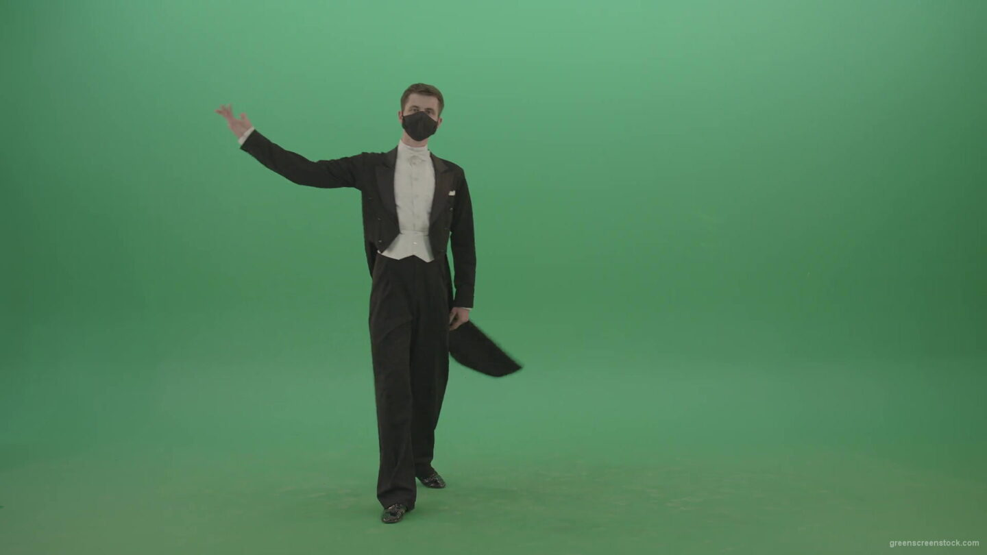 Man-in-Classical-ballroom-suite-making-wish-regards-to-impres-audience-in-black-medicine-mask-on-green-screen-4K-Video-Footage-1920_004 Green Screen Stock